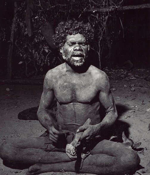 An image of Mangudja, singing his moraiin song, Liverpool River Arnhem Land by Axel Poignant