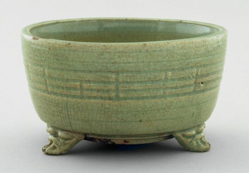 An image of Tripod incense burner with trigrams decoration by Longquan ware